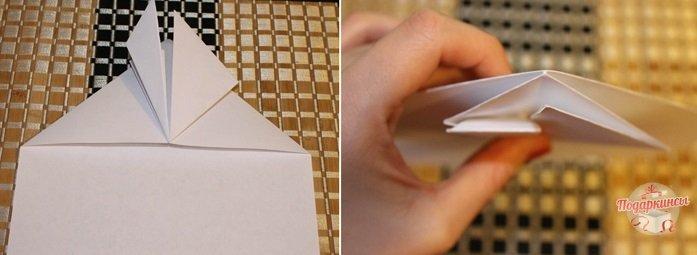 Необходимо еще раз согнуть лист бумаги к серединке.